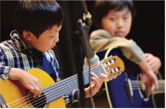 CWC student playing guitar